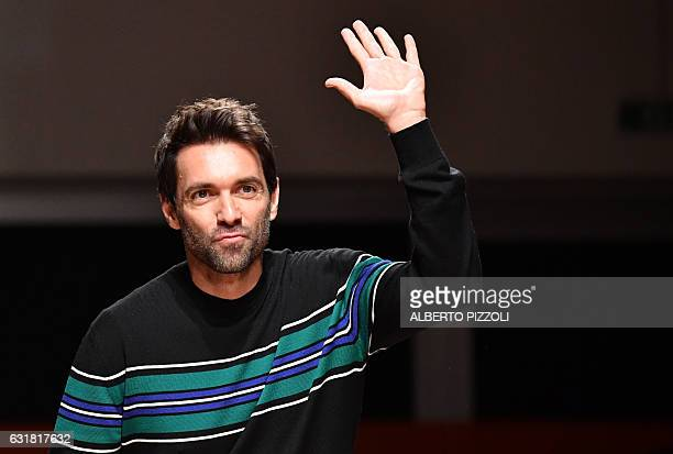 Designer Massimo Giorgetti greets the audience at the end of the show for fashion house MSGM during the Men's FallWinter 20172018 fashion week on...