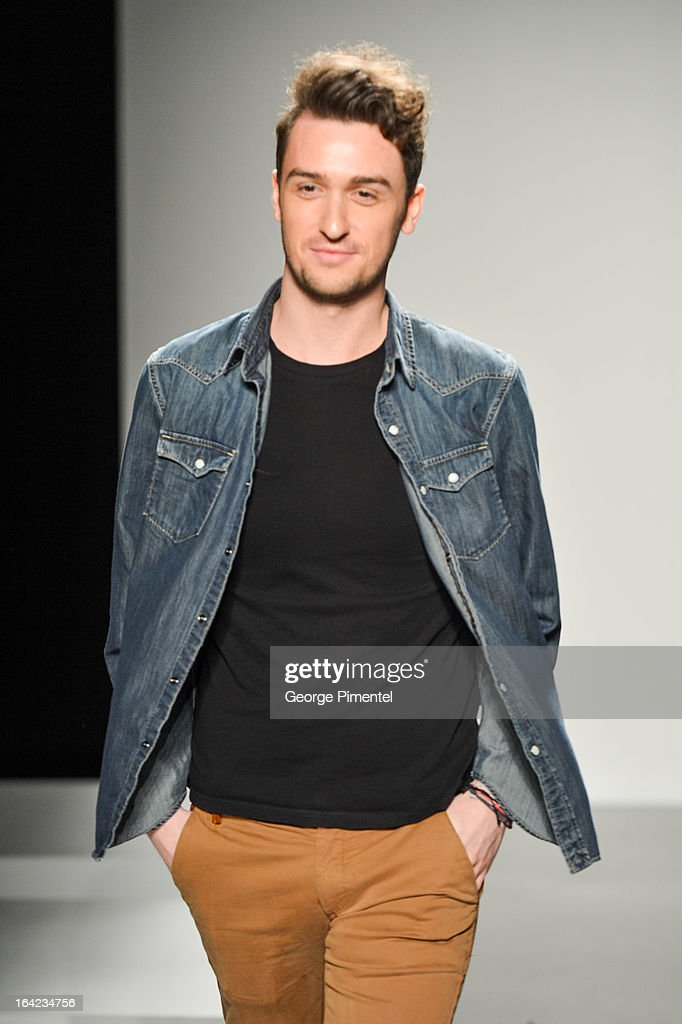 Designer <a gi-track='captionPersonalityLinkClicked' href=/galleries/search?phrase=Matthew+Gallagher+-+Fashion+Designer&family=editorial&specificpeople=12571561 ng-click='$event.stopPropagation()'>Matthew Gallagher</a> presents his fall 2013 collection during World MasterCard Fashion Week Fall 2013 at David Pecaut Square on March 21, 2013 in Toronto, Canada.