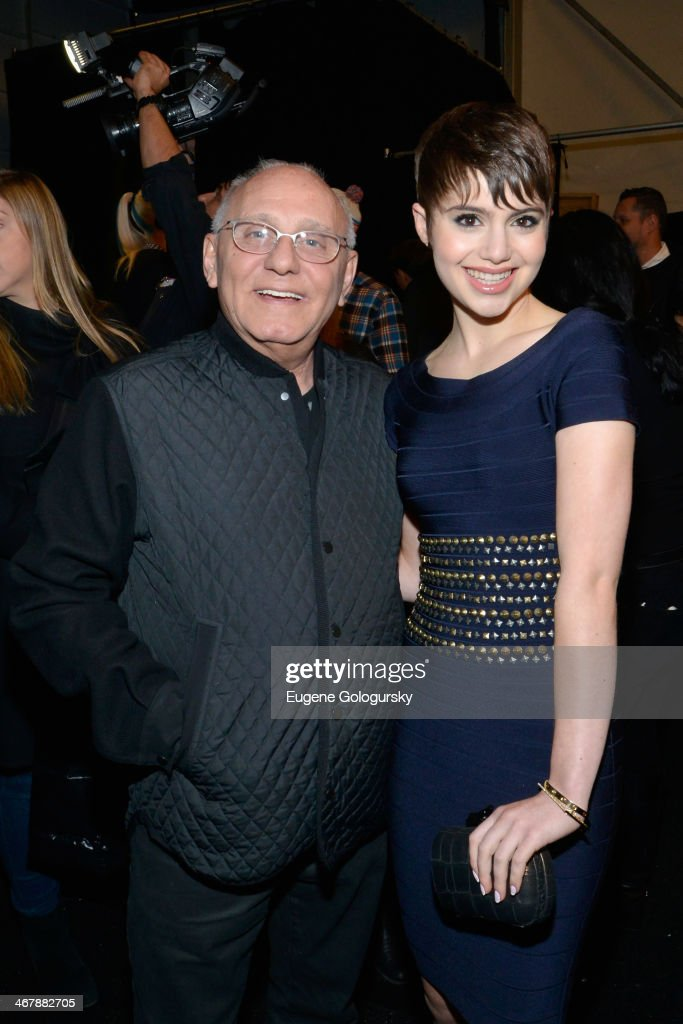 Designer Max Azaria and Sami Gayle pose backstage at the Herve Leger By Max Azria fashion show during MercedesBenz Fashion Week Fall 2014 at The...