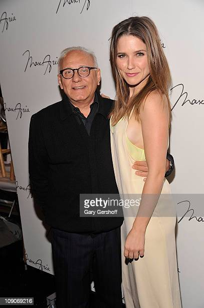 Designer Max Azria and Sophie Bush pose for pictures backstage at the Max Azria Fall 2011 fashion show during MercedesBenz Fashion Week at The Stage...