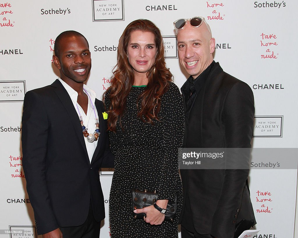 Designer McKenzie Liautaud, actress <a gi-track='captionPersonalityLinkClicked' href=/galleries/search?phrase=Brooke+Shields&family=editorial&specificpeople=202197 ng-click='$event.stopPropagation()'>Brooke Shields</a>, and stylist <a gi-track='captionPersonalityLinkClicked' href=/galleries/search?phrase=Robert+Verdi&family=editorial&specificpeople=209358 ng-click='$event.stopPropagation()'>Robert Verdi</a> attend the 2012 Take Home a Nude Benefit Art Auction at Sotheby's on October 18, 2012 in New York City.