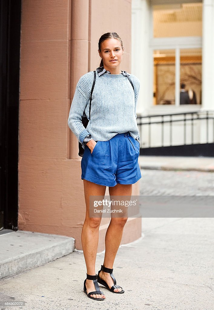 Designer Megan Soden is seen around Soho wearing a Jack and Jack sweater, Steven Allen shorts and Common Project sandals on August 28, 2014 in New York City.
