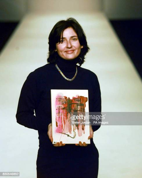 Designer Melanie Lucking for Guvinda with a Waterford Wedgewood plaque entitled 'The Elegant Woman' at London Fashion Week 2001 Designers have...