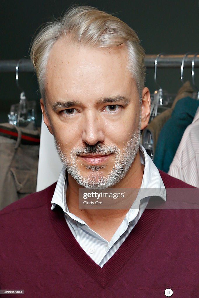 Designer Michael Bastian poses backstage at the Michael Bastian fall 2014 fashion show at Rubin Museum of Art on February 4, 2014 in New York City.
