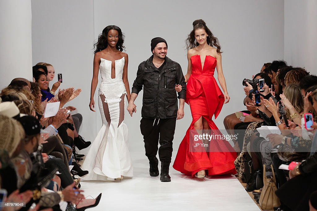 Designer Michael Costello walks the runway at the Michael Costello Fall 2014 Collection during Mercedes-Benz Fashion Week Fall 2014 at Helen Mills Event Space on February 8, 2014 in New York City.