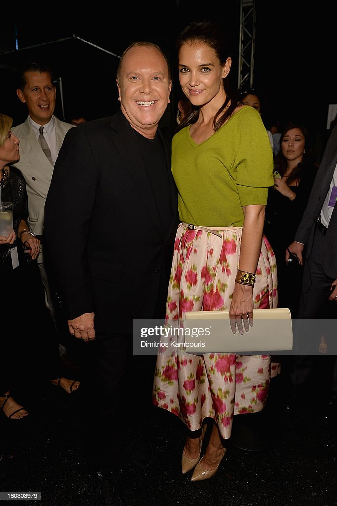 Designer <a gi-track='captionPersonalityLinkClicked' href=/galleries/search?phrase=Michael+Kors+-+Fashion+Designer&family=editorial&specificpeople=4289231 ng-click='$event.stopPropagation()'>Michael Kors</a> (L) and actress <a gi-track='captionPersonalityLinkClicked' href=/galleries/search?phrase=Katie+Holmes&family=editorial&specificpeople=201598 ng-click='$event.stopPropagation()'>Katie Holmes</a> pose backstage at the <a gi-track='captionPersonalityLinkClicked' href=/galleries/search?phrase=Michael+Kors+-+Fashion+Designer&family=editorial&specificpeople=4289231 ng-click='$event.stopPropagation()'>Michael Kors</a> fashion show during Mercedes-Benz Fashion Week Spring 2014 at The Theatre at Lincoln Center on September 11, 2013 in New York City.