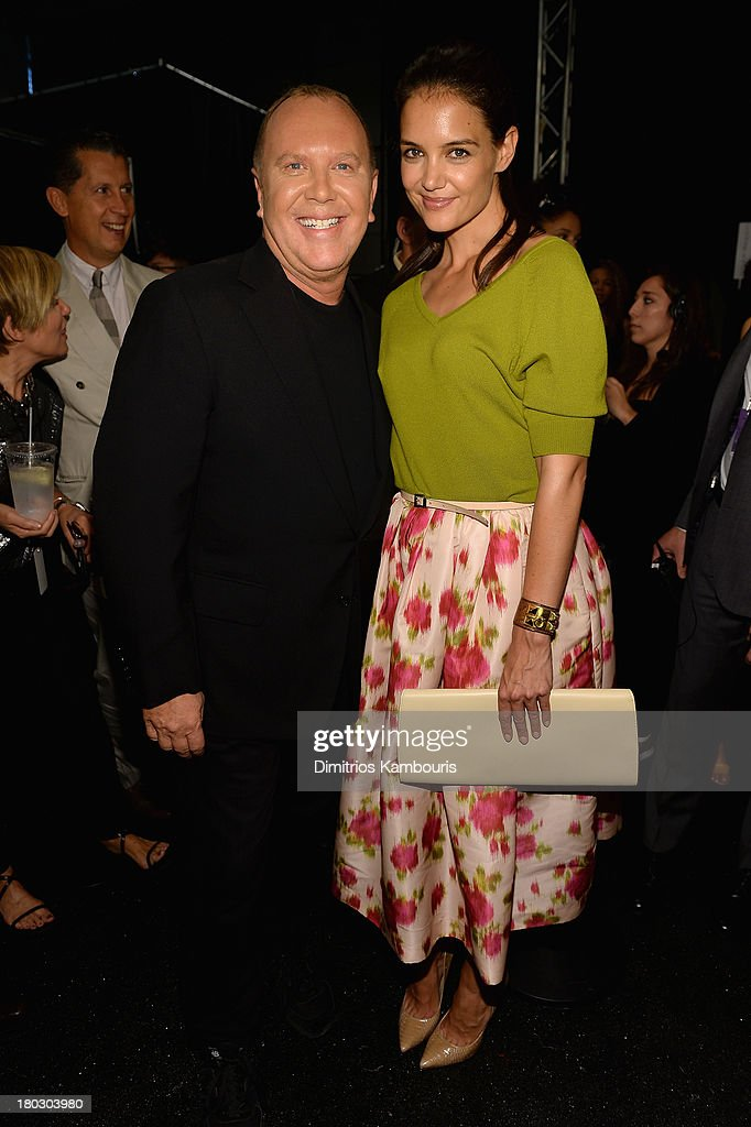Designer Michael Kors and actress Katie Holmes pose backstage at the Michael Kors fashion show during MercedesBenz Fashion Week Spring 2014 at The...