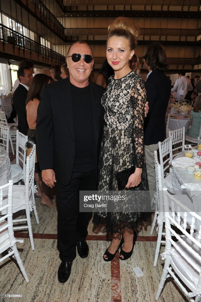 Designer Michael Kors and actress Nina Arianda attend The Couture Council of The Museum at the Fashion Institute of Technology hosted luncheon honoring Michael Kors with the 2013 Couture Council Award on September 4, 2013 in New York City.