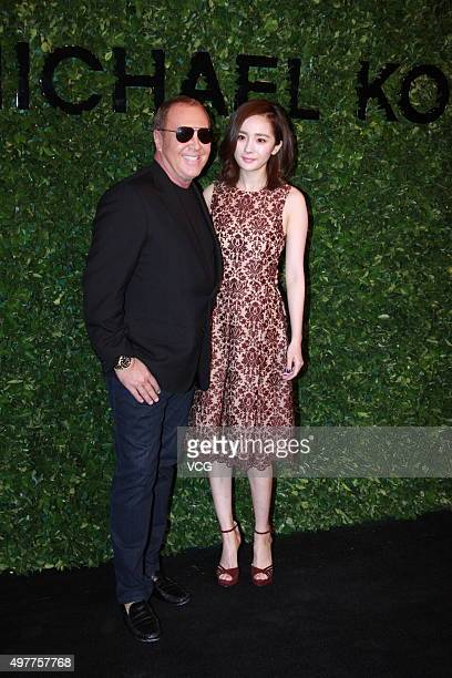 Designer Michael Kors and actress Yang Mi attend the opening reception of Michael Kors' new store on November 18 2015 in Beijing China