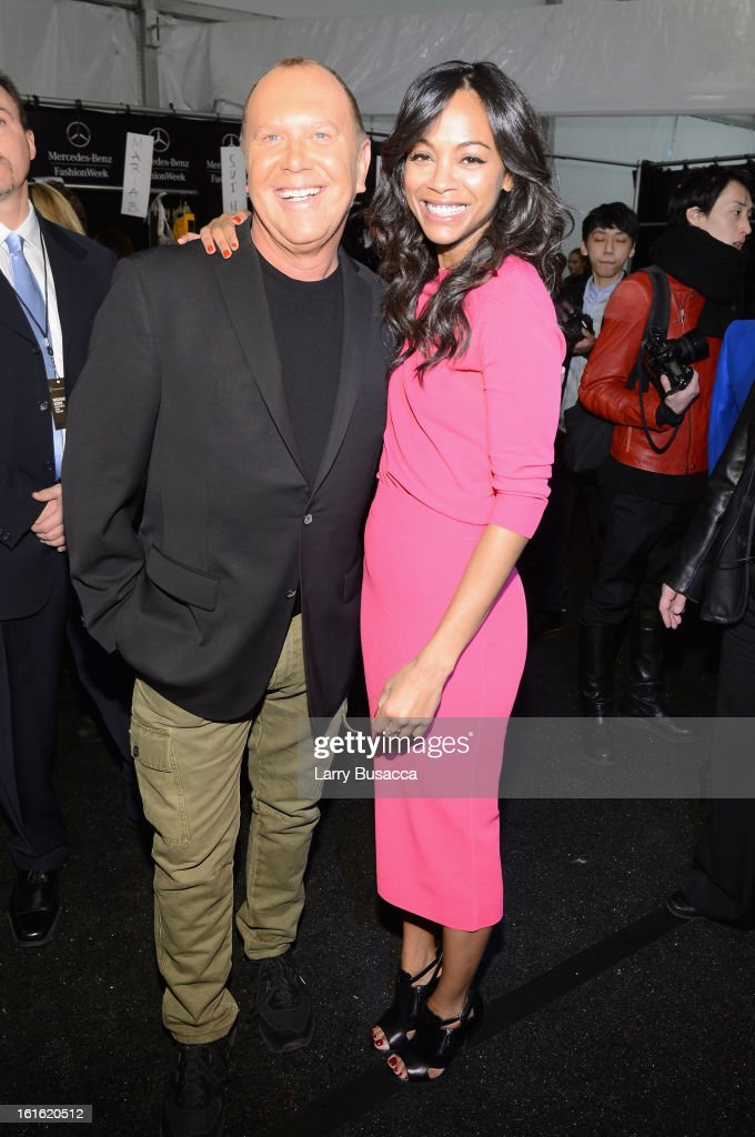 Designer Michael Kors (L) and actress <a gi-track='captionPersonalityLinkClicked' href=/galleries/search?phrase=Zoe+Saldana&family=editorial&specificpeople=542691 ng-click='$event.stopPropagation()'>Zoe Saldana</a> pose backstage at the Michael Kors Fall 2013 fashion show during Mercedes-Benz Fashion Week at The Theatre at Lincoln Center on February 13, 2013 in New York City.
