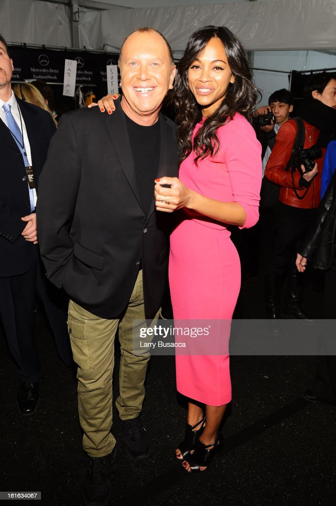 Designer Michael Kors and actress <a gi-track='captionPersonalityLinkClicked' href=/galleries/search?phrase=Zoe+Saldana&family=editorial&specificpeople=542691 ng-click='$event.stopPropagation()'>Zoe Saldana</a> pose backstage at the Michael Kors Fall 2013 fashion show during Mercedes-Benz Fashion Week at The Theatre at Lincoln Center on February 13, 2013 in New York City.
