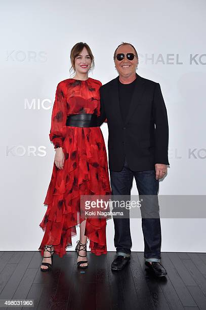 Designer Michael Kors and Dakota Johnson attend the opening event for the Michael Kors Ginza Flagship Store on November 20 2015 in Tokyo Japan