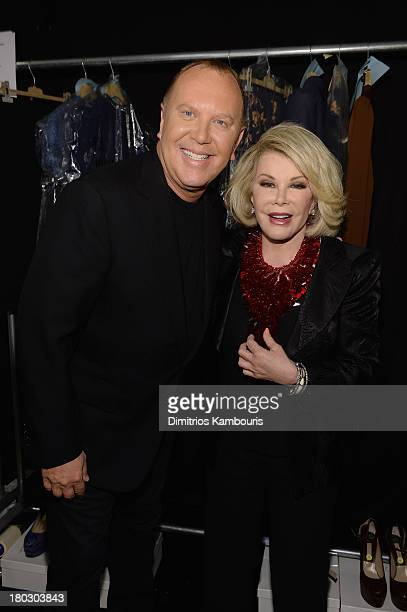 Designer Michael Kors and Joan Rivers pose backstage at the Michael Kors fashion show during MercedesBenz Fashion Week Spring 2014 at The Theatre at...