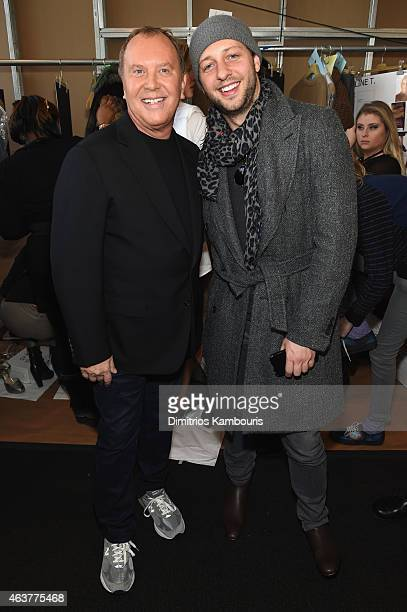 Designer Michael Kors and Lance LePere pose backstage at the Michael Kors fashion show during MercedesBenz Fashion Week Fall 2015 at Spring Studios...
