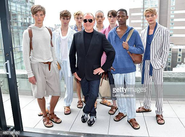 Designer Michael Kors and models pose at the Michael Kors Spring 2016 Presentation during New York Fashion Week Men's at Spring Studios on July 15...