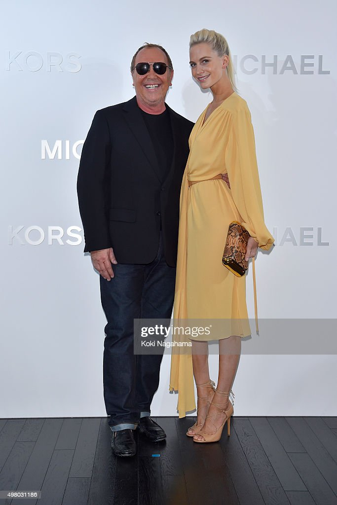 Designer Michael Kors (L) and Poppy Delevingne attend the opening event for the Michael Kors Ginza Flagship Store on November 20, 2015 in Tokyo, Japan.