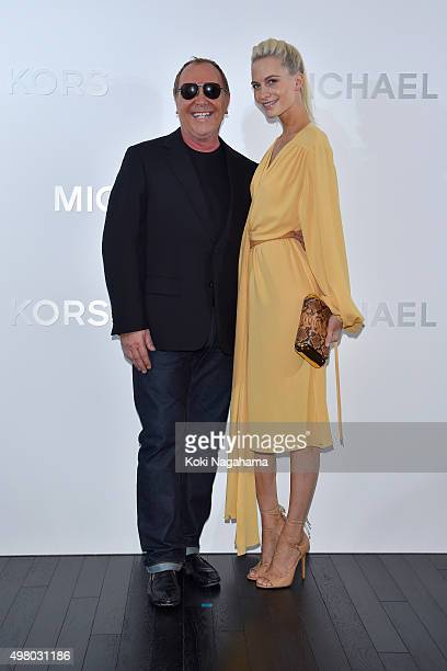 Designer Michael Kors and Poppy Delevingne attend the opening event for the Michael Kors Ginza Flagship Store on November 20 2015 in Tokyo Japan