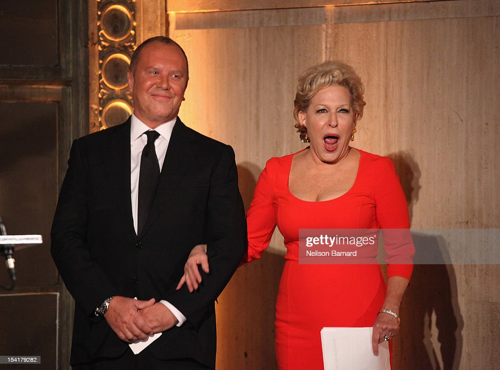 Designer Michael Kors and singer <a gi-track='captionPersonalityLinkClicked' href=/galleries/search?phrase=Bette+Midler&family=editorial&specificpeople=201551 ng-click='$event.stopPropagation()'>Bette Midler</a> speak onstage at the Michael Kors- Golden Heart Gala at Cunard Building on October 15, 2012 in New York City.