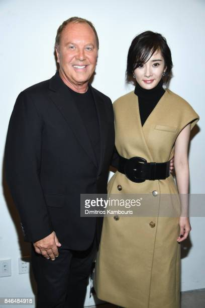 Designer Michael Kors and Yang Mi pose backstage at the Michael Kors Collection Spring 2018 Runway Show at Spring Studios on September 13 2017 in New...