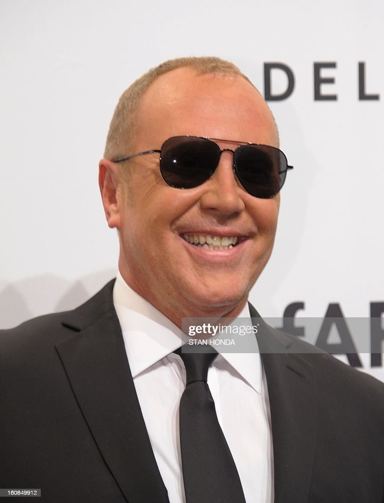 Designer Michael Kors arrives at the amfAR (The Foundation for AIDS Research) gala that kicks off the Mercedes-Benz Fashion Week February 6, 2013 in New York. AFP PHOTO/Stan HONDA