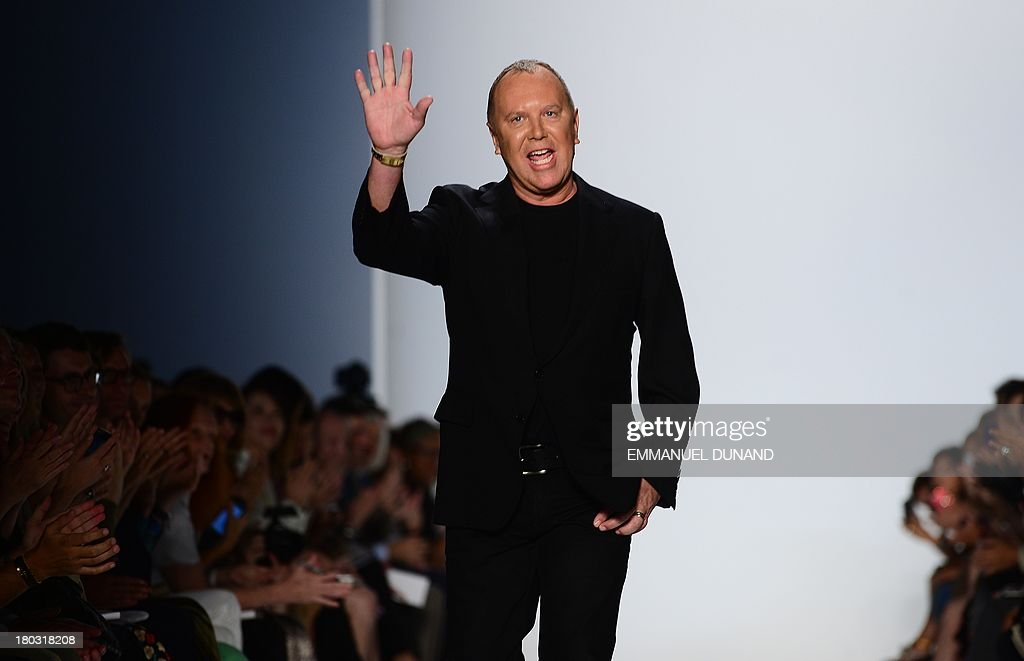 Designer <a gi-track='captionPersonalityLinkClicked' href=/galleries/search?phrase=Michael+Kors+-+Fashion+Designer&family=editorial&specificpeople=4289231 ng-click='$event.stopPropagation()'>Michael Kors</a> greets spectators following his show during the Mercedes-Benz Fashion Week Spring 2014 collection in New York on September 11, 2013. AFP PHOTO/Emmanuel Dunand