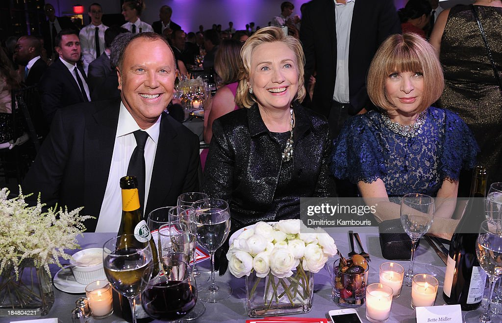 Designer Michael Kors, Hillary Rodham Clinton, recipient of the Michael Kors Award for Outstanding Community Service, and Vogue editor-in-chief Anna Wintour attend God's Love We Deliver 2013 Golden Heart Awards Celebration at Spring Studios on October 16, 2013 in New York City.