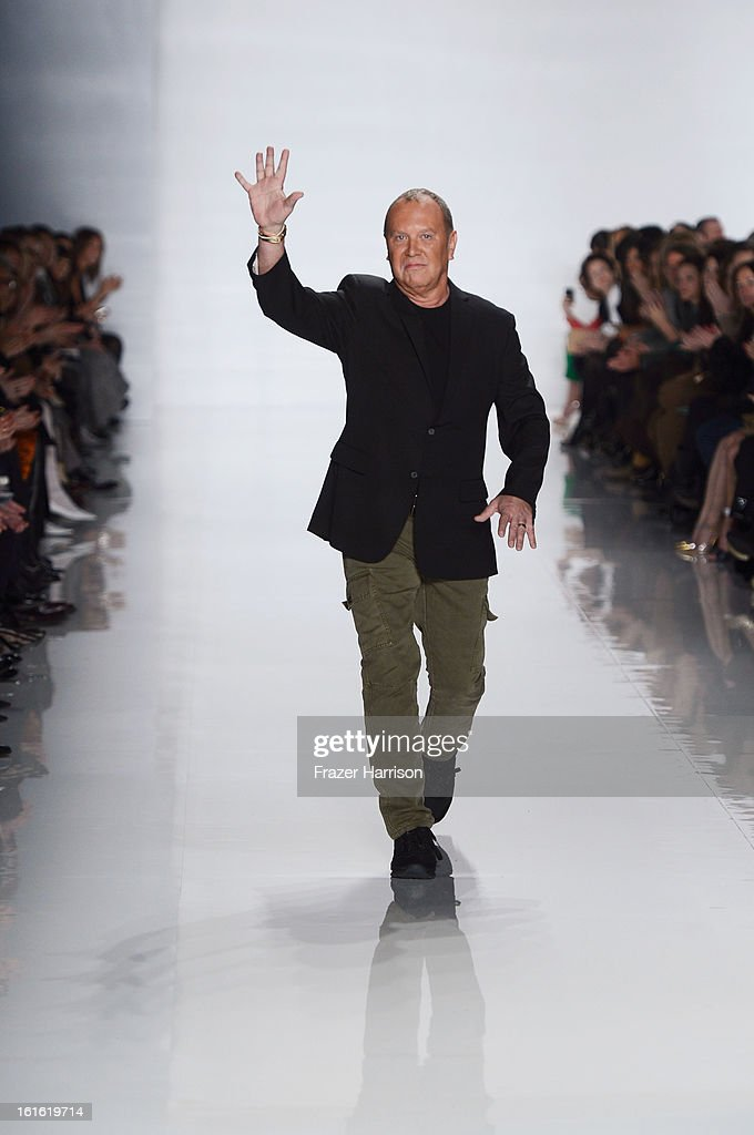 Designer Michael Kors walks the runway at the Michael Kors Fall 2013 fashion show during Mercedes-Benz Fashion Week at The Theatre at Lincoln Center on February 13, 2013 in New York City.