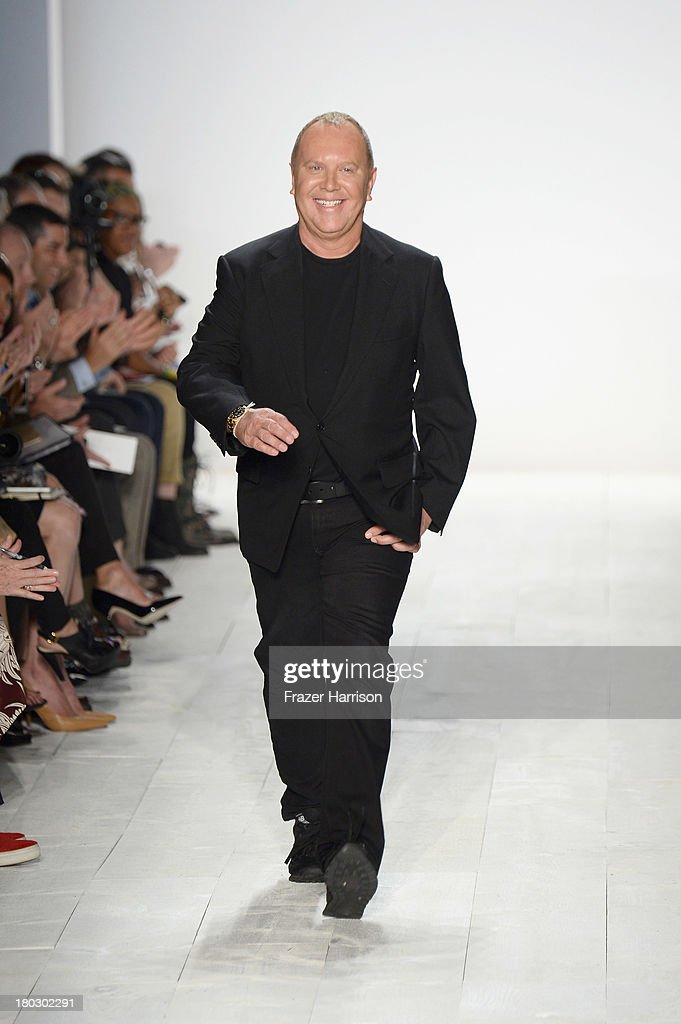 Designer Michael Kors walks the runway at the Michael Kors fashion show during Mercedes-Benz Fashion Week Spring 2014 at The Theatre at Lincoln Center on September 11, 2013 in New York City.