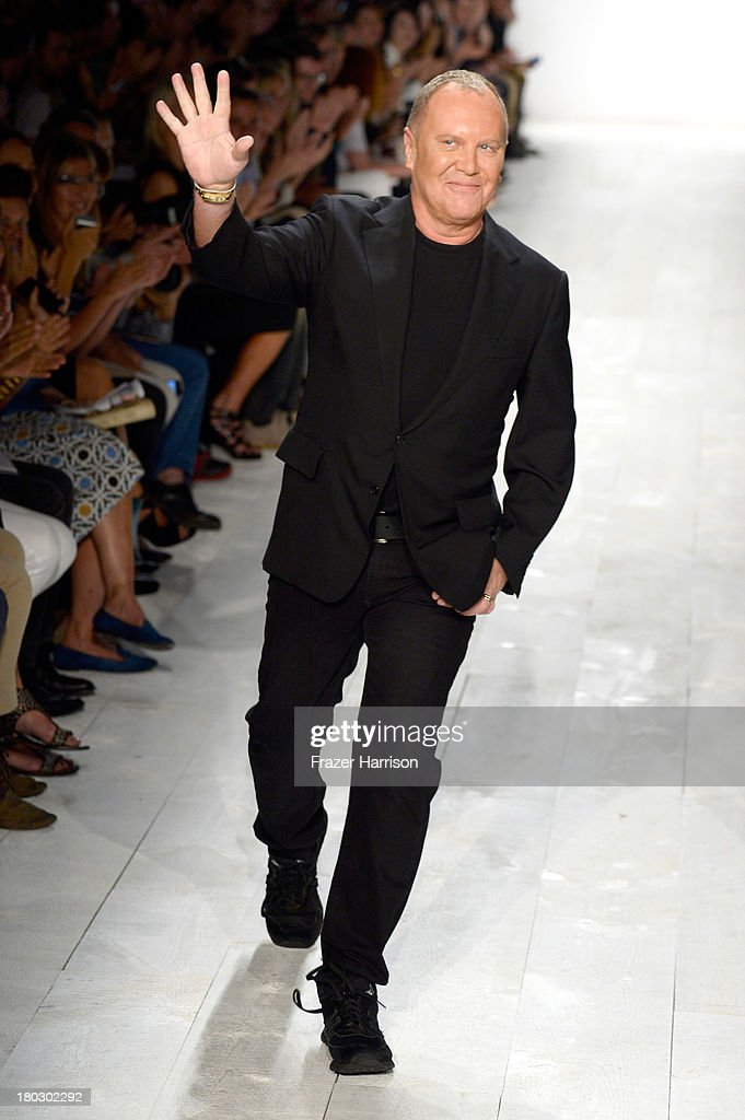 Designer <a gi-track='captionPersonalityLinkClicked' href=/galleries/search?phrase=Michael+Kors+-+Fashion+Designer&family=editorial&specificpeople=4289231 ng-click='$event.stopPropagation()'>Michael Kors</a> walks the runway at the <a gi-track='captionPersonalityLinkClicked' href=/galleries/search?phrase=Michael+Kors+-+Fashion+Designer&family=editorial&specificpeople=4289231 ng-click='$event.stopPropagation()'>Michael Kors</a> fashion show during Mercedes-Benz Fashion Week Spring 2014 at The Theatre at Lincoln Center on September 11, 2013 in New York City.