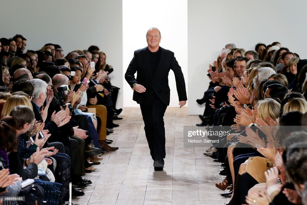 Designer <a gi-track='captionPersonalityLinkClicked' href=/galleries/search?phrase=Michael+Kors+-+Fashion+Designer&family=editorial&specificpeople=4289231 ng-click='$event.stopPropagation()'>Michael Kors</a> walks the runway at the <a gi-track='captionPersonalityLinkClicked' href=/galleries/search?phrase=Michael+Kors+-+Fashion+Designer&family=editorial&specificpeople=4289231 ng-click='$event.stopPropagation()'>Michael Kors</a> fashion show during Mercedes-Benz Fashion Week Fall 2014 at Spring Studios on February 12, 2014 in New York City.