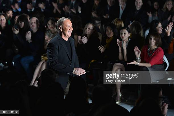 Designer Michael Kors walks the runway during the Michael Kors Fall 2013 fashion show during MercedesBenz Fashion Week at The Theatre at Lincoln...