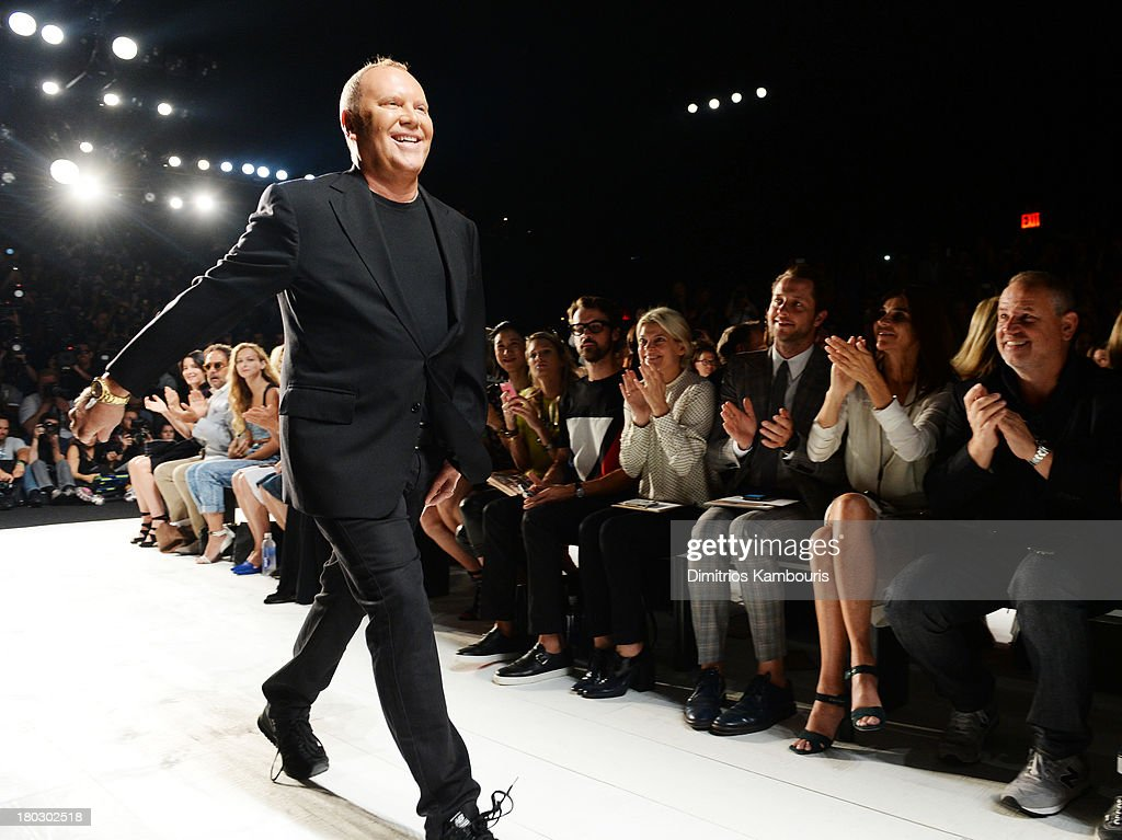 Designer <a gi-track='captionPersonalityLinkClicked' href=/galleries/search?phrase=Michael+Kors+-+Fashion+Designer&family=editorial&specificpeople=4289231 ng-click='$event.stopPropagation()'>Michael Kors</a> walks the runway during the <a gi-track='captionPersonalityLinkClicked' href=/galleries/search?phrase=Michael+Kors+-+Fashion+Designer&family=editorial&specificpeople=4289231 ng-click='$event.stopPropagation()'>Michael Kors</a> fashion show during Mercedes-Benz Fashion Week Spring 2014 at The Theatre at Lincoln Center on September 11, 2013 in New York City.