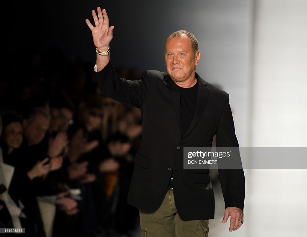 Designer Michael Kors waves to the audience after his show at the Mercedes-Benz fashion week on February 13, 2013 in New York.