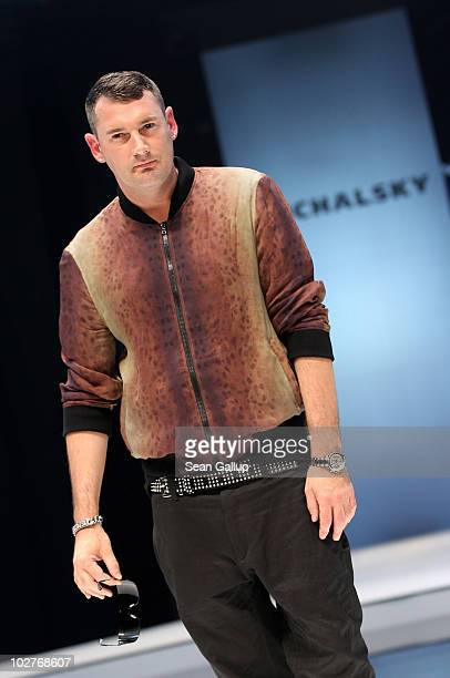 Designer Michael Michalsky presents himself on the runway following the Michalsky Show at the Michalsky Style Nite at Tempodrom during the Mercedes...