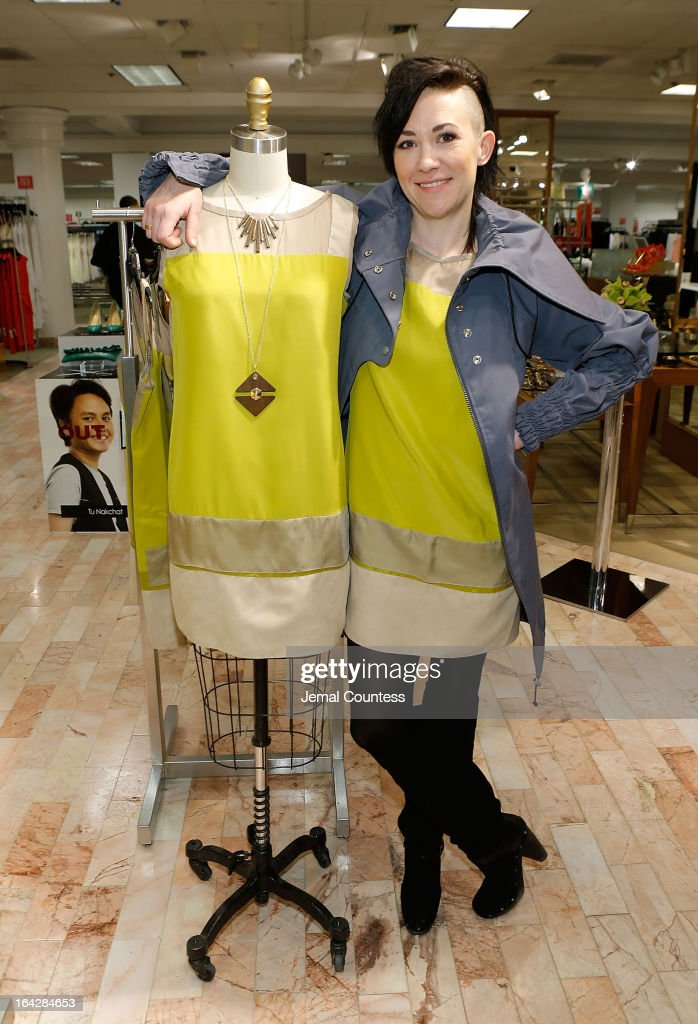 Designer Michelle Franklin poses with her Project Runway Lord & Taylor challenge winning design during an in-store visit to the Lord & Taylor Flagship store on March 22, 2013 in New York City.