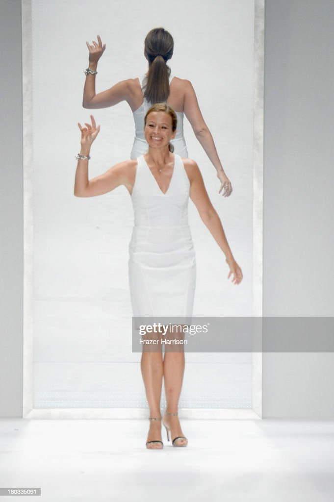 Designer <a gi-track='captionPersonalityLinkClicked' href=/galleries/search?phrase=Michelle+Smith+-+Fashion+Designer&family=editorial&specificpeople=11464513 ng-click='$event.stopPropagation()'>Michelle Smith</a> walks the runway at the Milly By <a gi-track='captionPersonalityLinkClicked' href=/galleries/search?phrase=Michelle+Smith+-+Fashion+Designer&family=editorial&specificpeople=11464513 ng-click='$event.stopPropagation()'>Michelle Smith</a> fashion show during Mercedes-Benz Fashion Week Spring 2014 on September 11, 2013 in New York City.