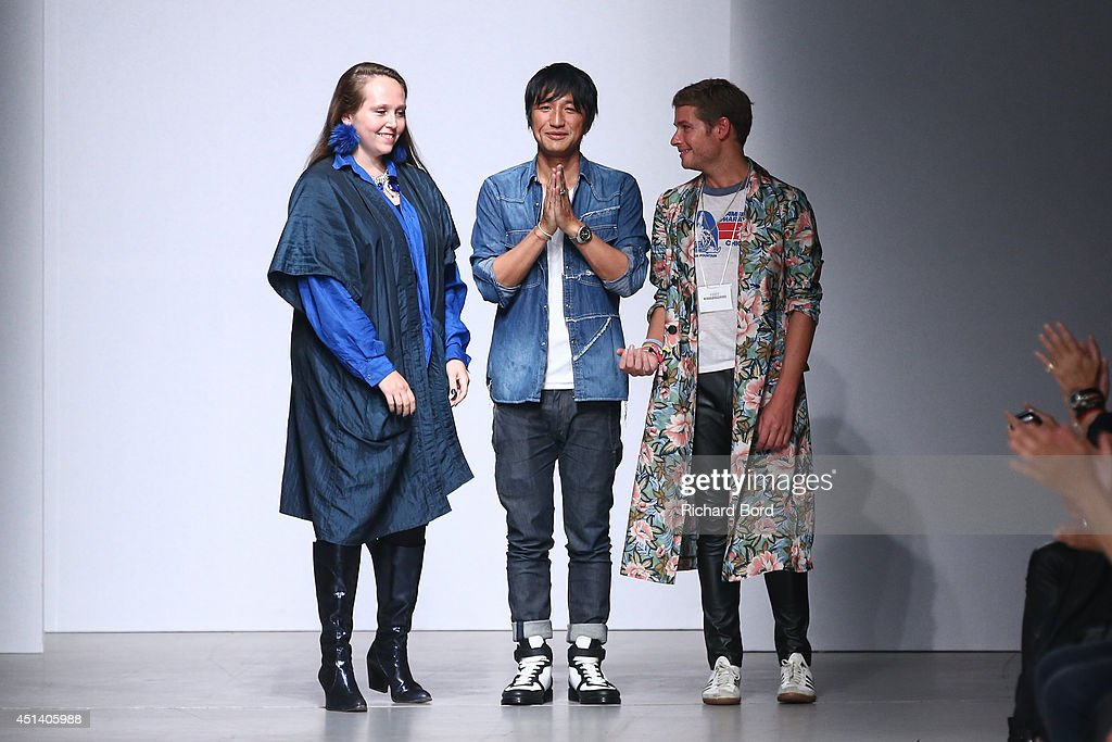 Designer Mihara Yasuhiro (C) and guests acknowledge the applause of the audience after the Miharayasuhiro show as part of the Paris Fashion Week Menswear Spring/Summer 2015 at Palais de Tokyo on June 28, 2014 in Paris, France.