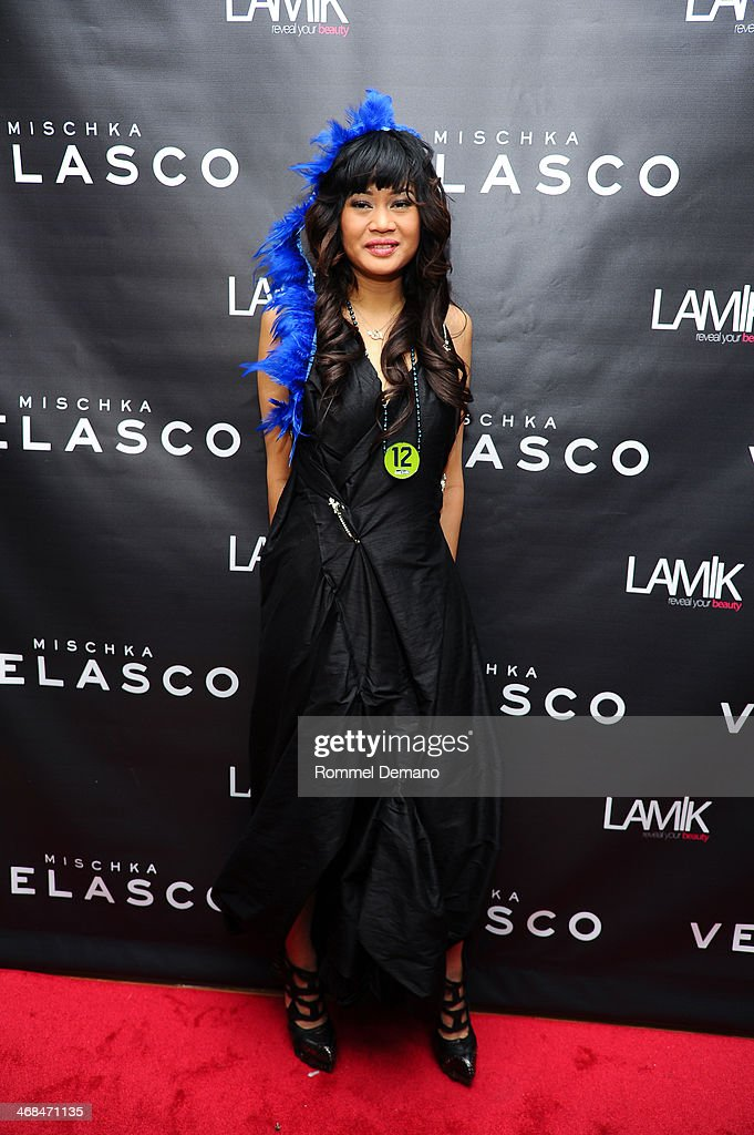 Designer Mischka Velasco attends the Mischka Velasco presentation during Mercedes-Benz Fashion Week Fall 2014 at Top of the Garden on February 10, 2014 in New York City.