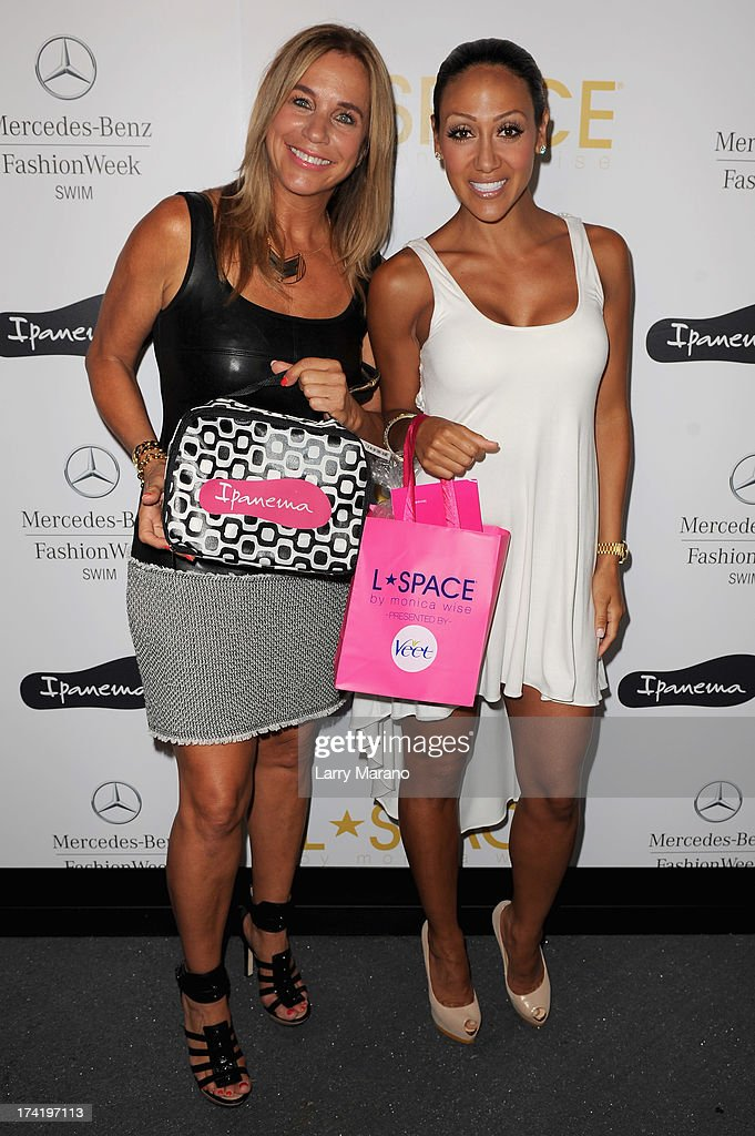 Designer Monica Wise (L) and Melissa Gorga pose backstage at the L*Space By Monica Wise show during Mercedes-Benz Fashion Week Swim 2014 at Cabana Grande at the Raleigh on July 21, 2013 in Miami, Florida.