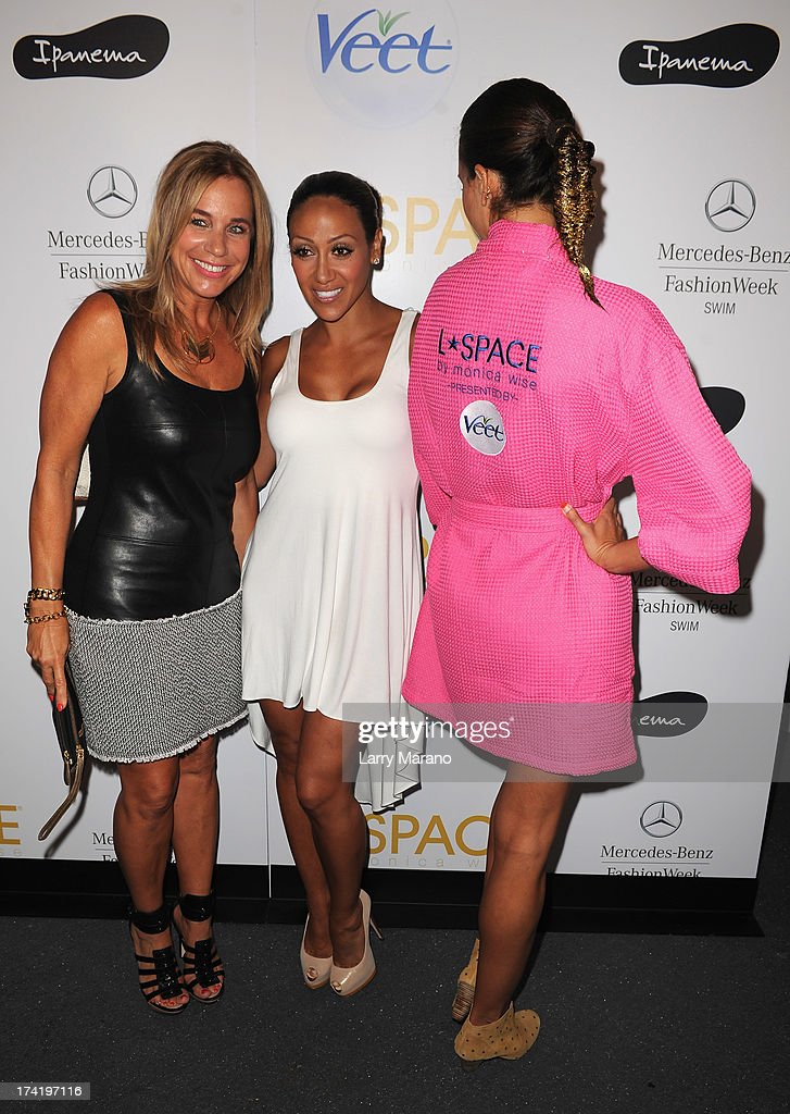 Designer Monica Wise (L) and <a gi-track='captionPersonalityLinkClicked' href=/galleries/search?phrase=Melissa+Gorga&family=editorial&specificpeople=7306775 ng-click='$event.stopPropagation()'>Melissa Gorga</a> pose backstage at the L*Space By Monica Wise show during Mercedes-Benz Fashion Week Swim 2014 at Cabana Grande at the Raleigh on July 21, 2013 in Miami, Florida.
