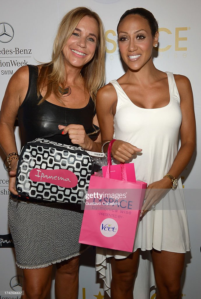 Designer Monica Wise (L) and Melissa Gorga pose backstage with Ipanema at the L*SPACE By Monica Wise show during Mercedes-Benz Fashion Week Swim 2014 at Cabana Grande at the Raleigh on July 21, 2013 in Miami, Florida.