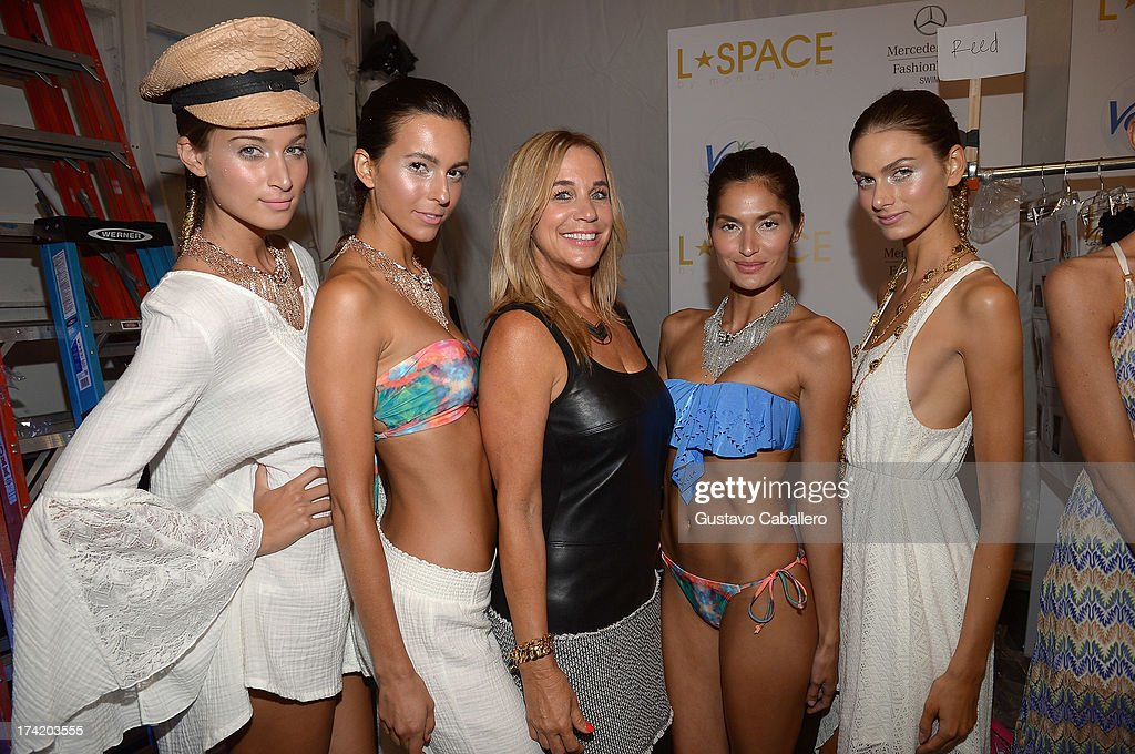 Designer Monica Wise (C) poses backstage with Ipanema at the L*SPACE By Monica Wise show during Mercedes-Benz Fashion Week Swim 2014 at Cabana Grande at the Raleigh on July 21, 2013 in Miami, Florida.