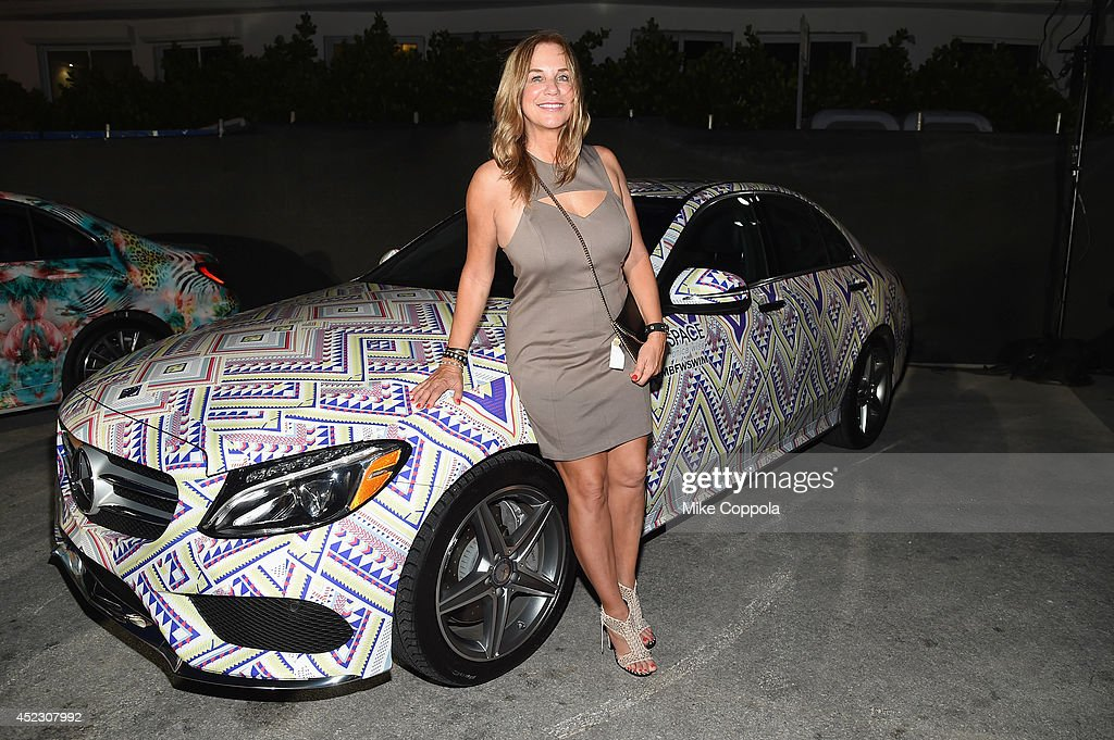 Designer Monica Wise poses with a 2015 MercedesBenz CClass featuring an exclusive design by L Space by Monica Wise on display during MercedesBenz...