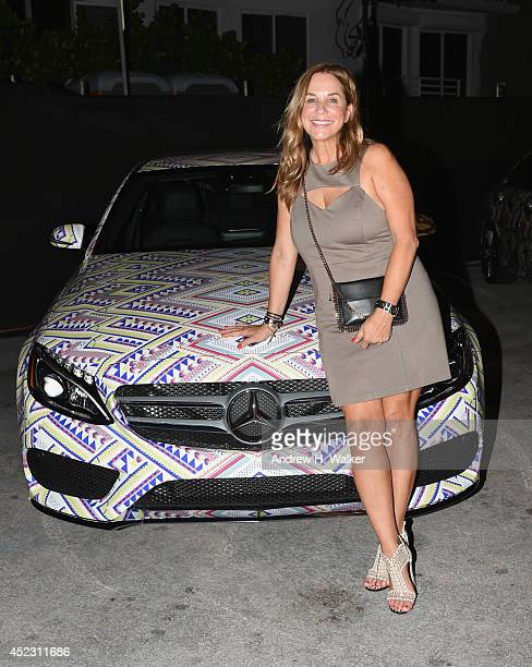Designer Monica Wise poses with a 2015 MercedesBenz CClass featuring an exclusive design by L Space by Monica Wise on display during the opening...
