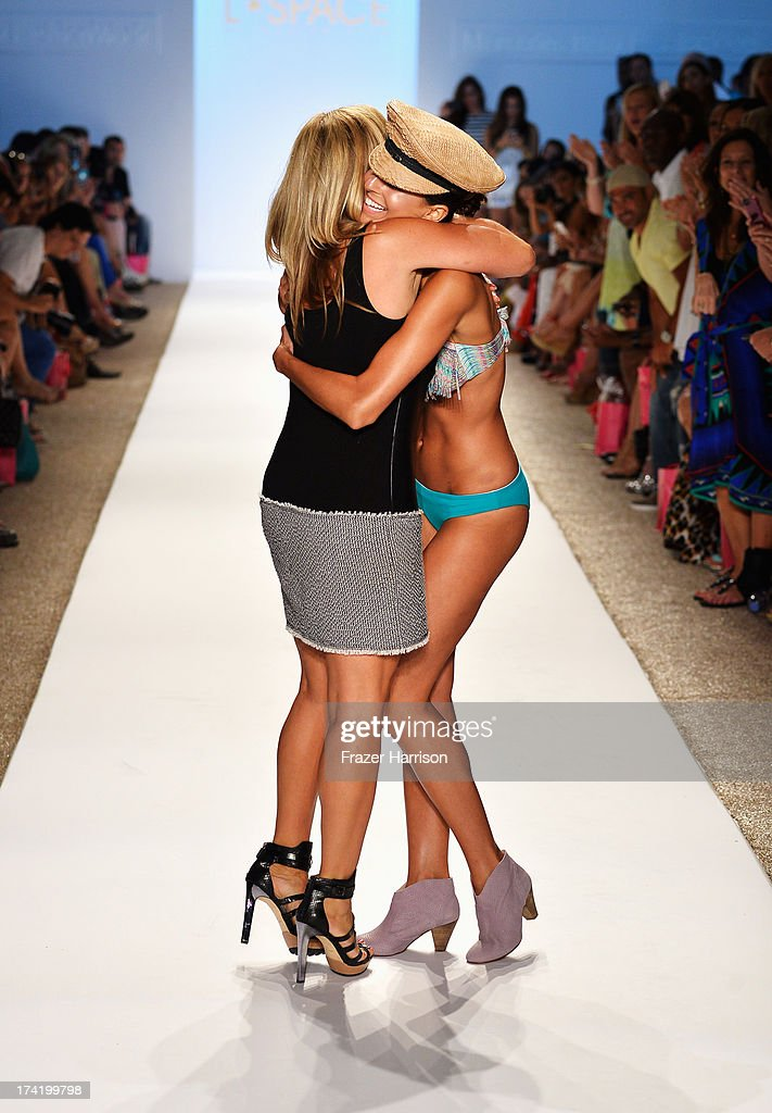 Designer Monica Wise (L) walks the runway at the L*Space By Monica Wise show during Mercedes-Benz Fashion Week Swim 2014 at Cabana Grande at the Raleigh on July 21, 2013 in Miami, Florida.