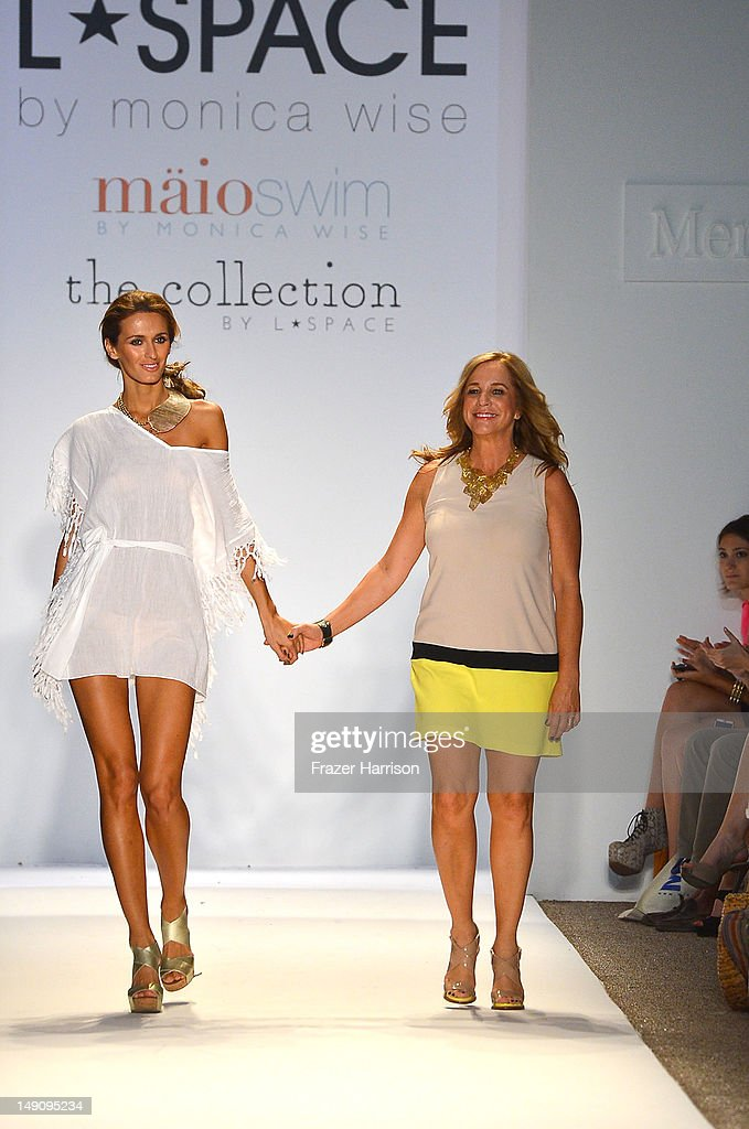Designer Monica Wise walks the runway with a model at the L Space By Monica Wise show during MercedesBenz Fashion Week Swim 2013 at The Raleigh on...