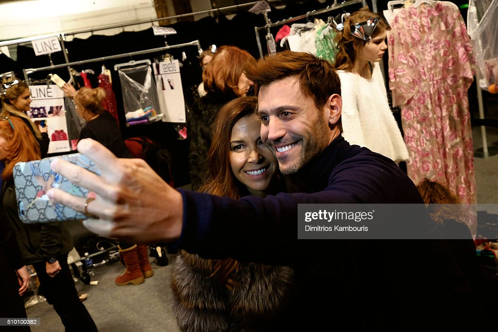 Designer Monique Lhuillier (L) poses backstage at the Monique Lhuillier Fall 2016 fashion show during New York Fashion Week: The Shows at The Arc, Skylight at Moynihan Station on February 13, 2016 in New York City.