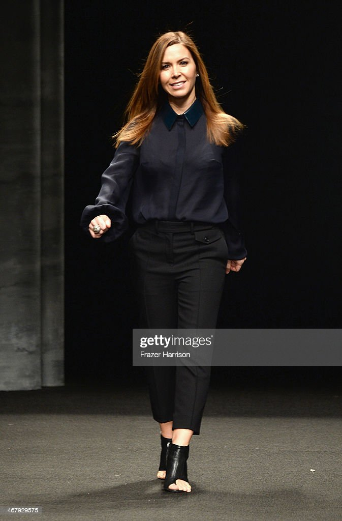 Designer Monique Lhuillier walks the runway at the Monique Lhuillier fashion show during Mercedes-Benz Fashion Week Fall 2014 at The Theatre at Lincoln Center on February 8, 2014 in New York City.