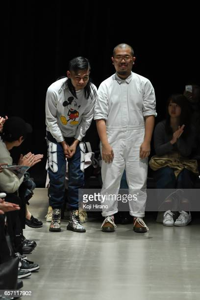 Designer MOTO GUO and KINDER ENG greet on the runway during the MOTO GUO show as a part of Amazon Fashion Week Tokyo A/W 2017 at Shibuya Hikarie on...