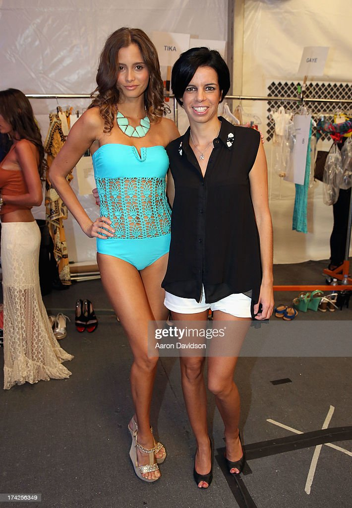 Designer <a gi-track='captionPersonalityLinkClicked' href=/galleries/search?phrase=Naila+Chbib&family=editorial&specificpeople=7106033 ng-click='$event.stopPropagation()'>Naila Chbib</a> (R) poses backstage at the Naila/ Sauvage/ Zingara Swimwear show At Mercedes-Benz Fashion Week Swim 2014 at Cabana Grande at the Raleigh on July 22, 2013 in Miami, Florida.